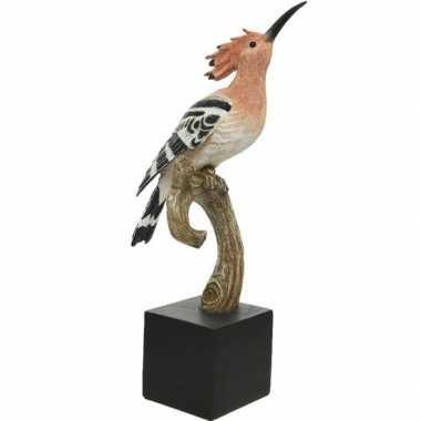 Dierenbeeld hop vogel 39 cm op tak/standaard
